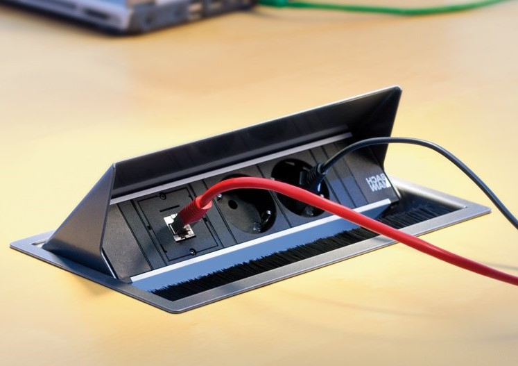 The Coni is an electrification built-in module for your desk | everything for your workplace visit Worktrainer.com