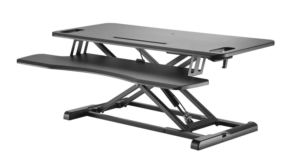 zit-sta verhoger zwart bureau  Updesk Cross Gasveer bureauverhoger staan achter je bureau | ergonomisch kantoormeubilair | Worktrainer.nl