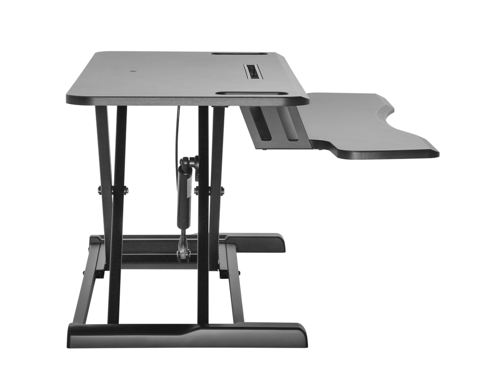 Updesk Cross gaslift desk riser | ergonomic office furniture | standing behind desk | Worktrainer.com
