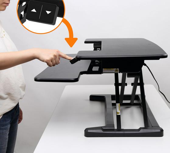 Updesk Cross elevator desk riser desktop riser | choose a healthy way of working visit Worktrainer.com